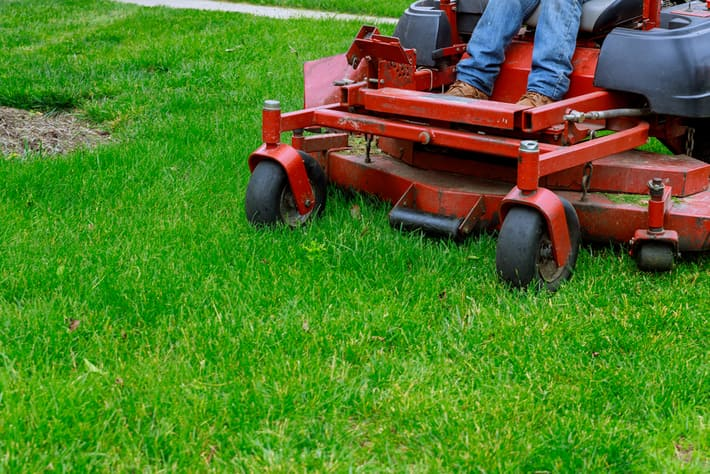 Lawn Mowing Services being performed for a residence in Carmel, Indiana